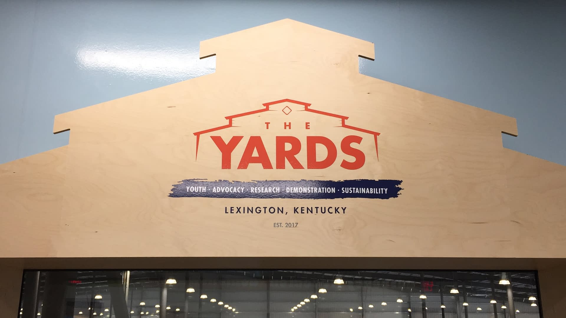 The Yards wood sign and graphic